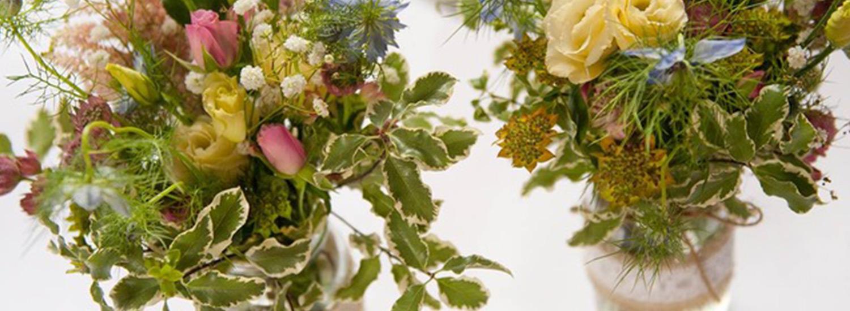 Beautiful flowers in glass jars - image