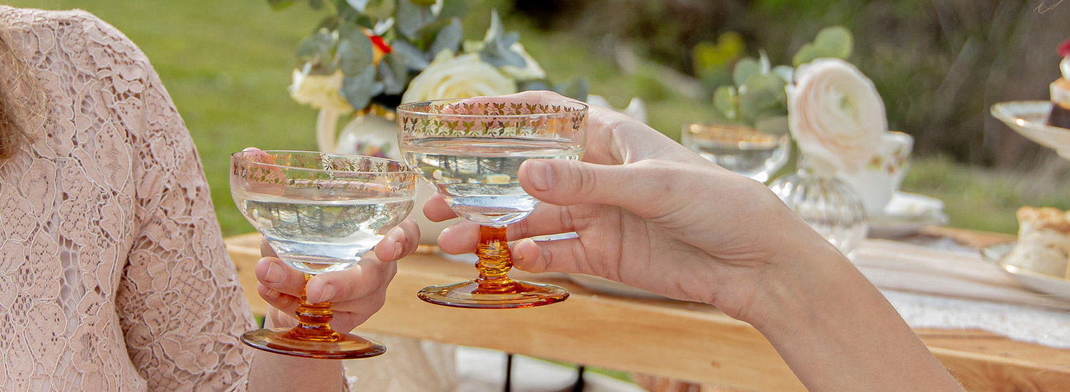 Lovely champagne coup glasses with afternoon tea - image